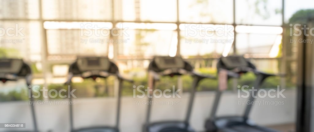 Blurred of fitness gym background for banner fitness exercise concept royalty-free stock photo