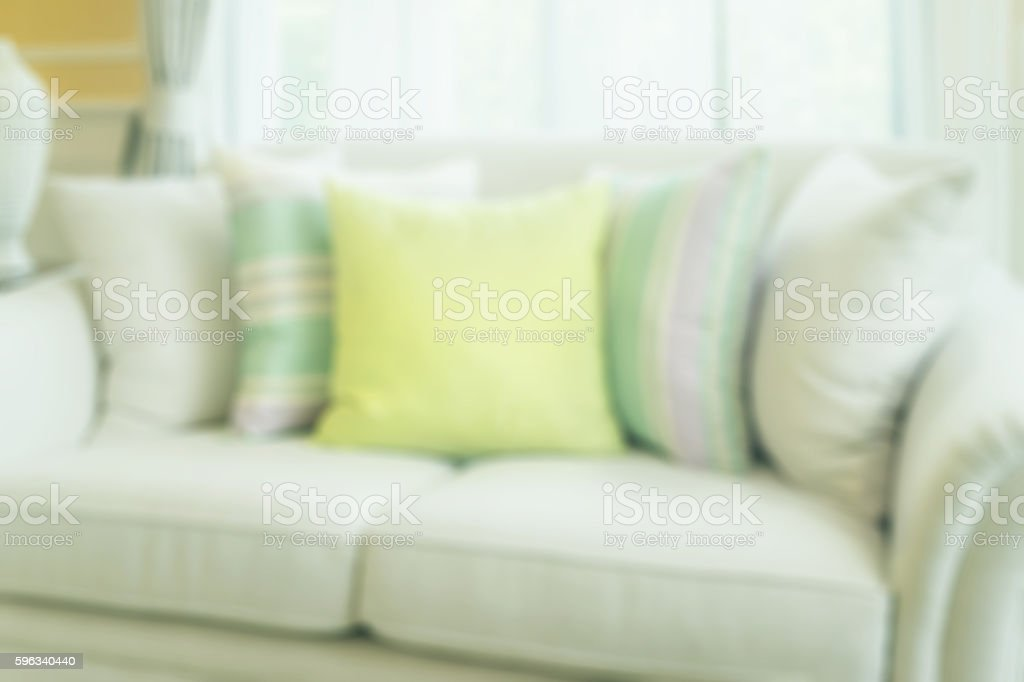 blurred of green pillows on modern sofa in living room royalty-free stock photo