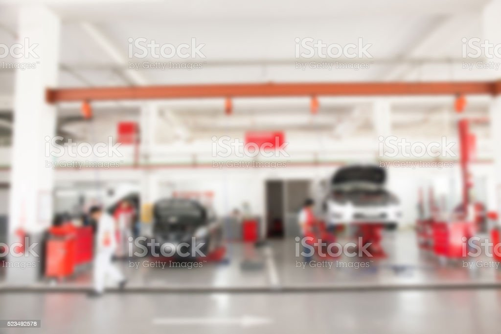 Blurred of inside car garage with cars being under maintenance stock photo