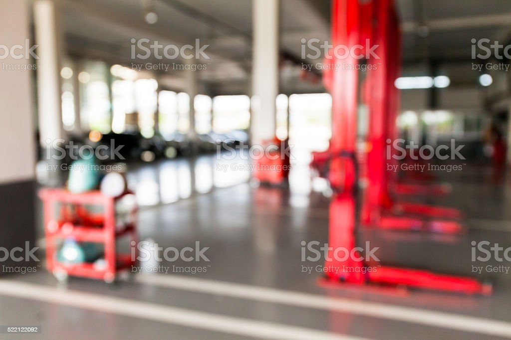 Blurred of inside car garage with cars stock photo