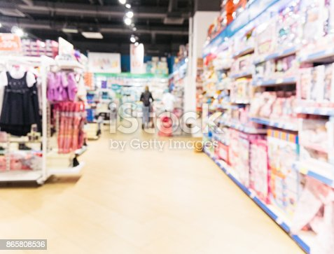 926078666 istock photo Blurred of kids toy store background 865808536