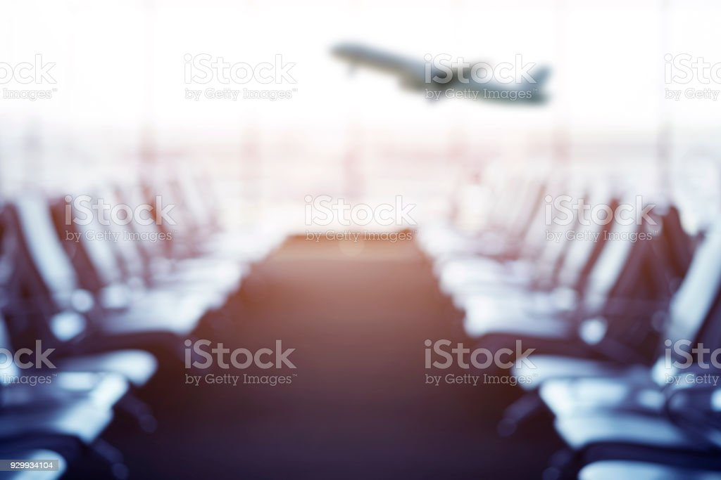 Blurred of Passenger seat in Departure lounge for see Airplane, Waiting hall, view from airport terminal. Transport and travel concept. stock photo