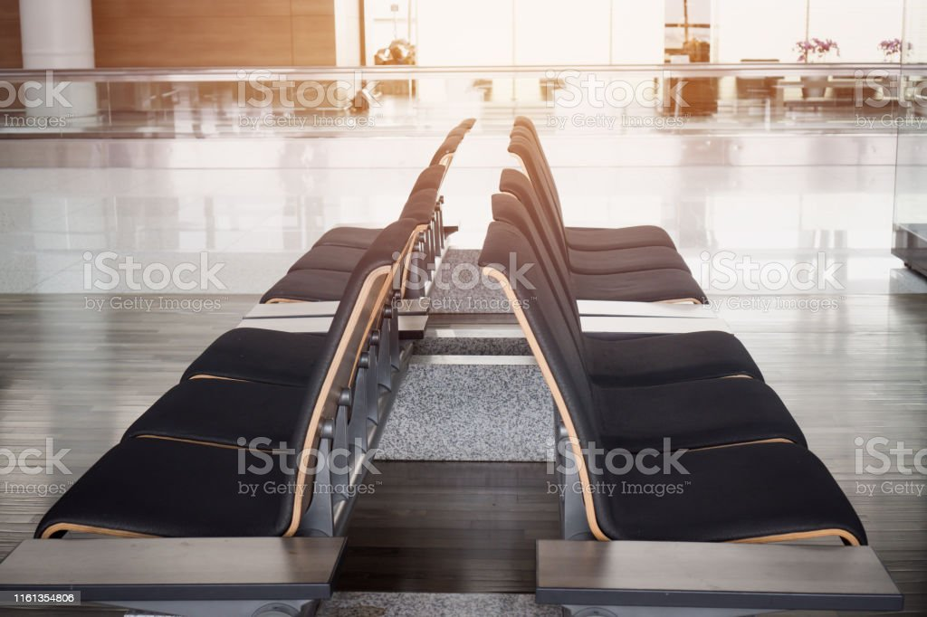 Blurred of seats for traveler waiting rest inside departure lounge at...