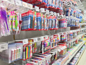 Blurred of stationery shop have many accessories such as pen, pencil, eraser, color, correction pen, post-it note, highlighting pen, ink and etc. Side view of School supplies on shelf for students.