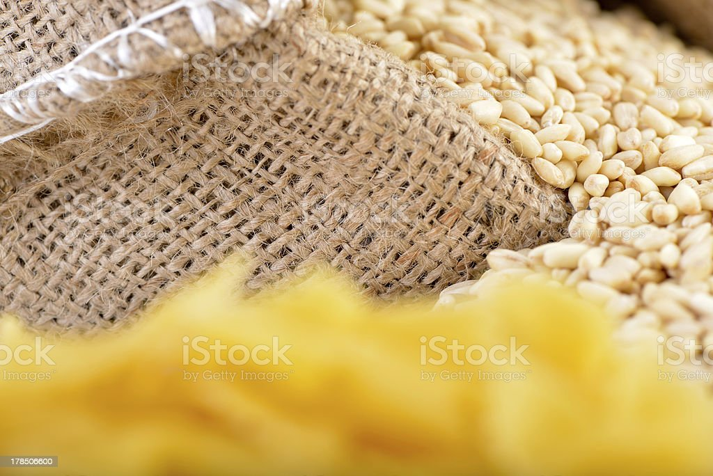 Blurred pasta in front of wheat royalty-free stock photo