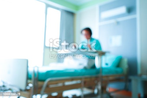 1127202747istockphoto Blurred patient on bed in Hospital standard VIP room with beds and comfortable medical equipped 1044059178