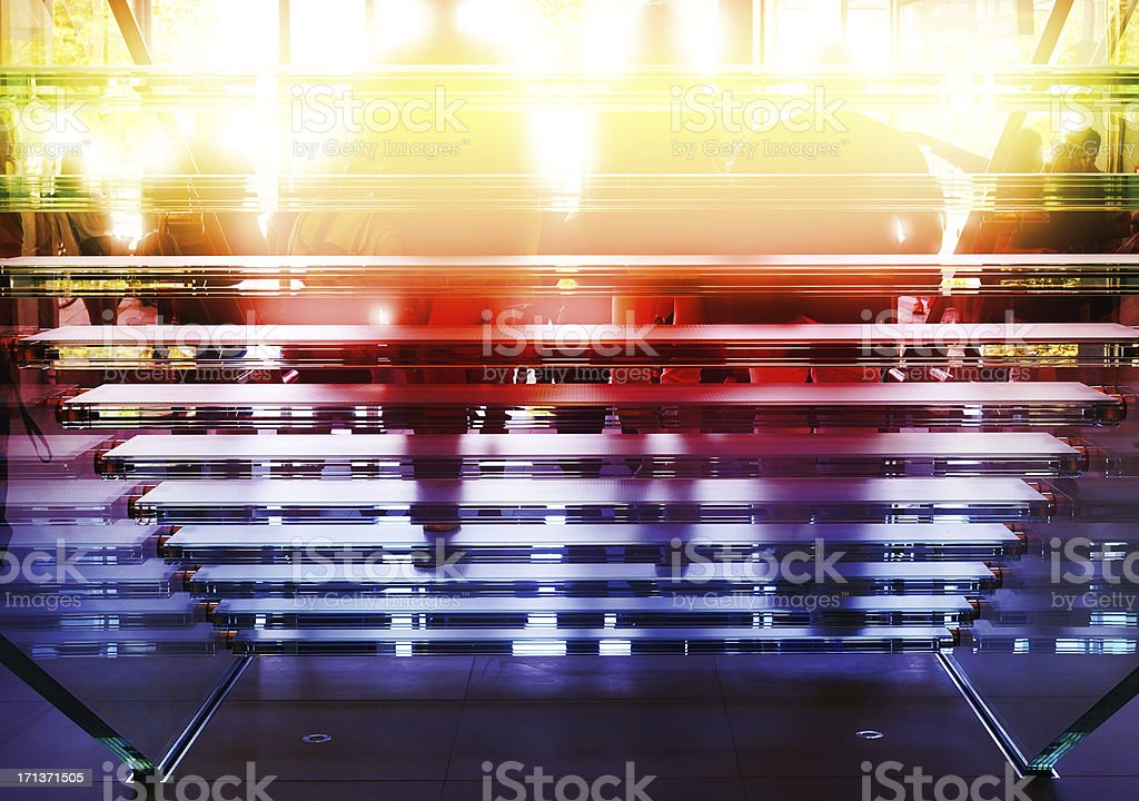 Blurred pedestrians exits building through glass stairs royalty-free stock photo