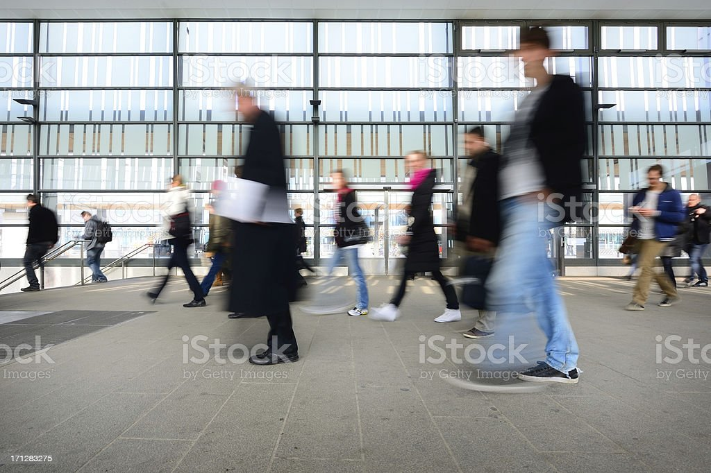 Blurred pedestrians in profile, travelling royalty-free stock photo