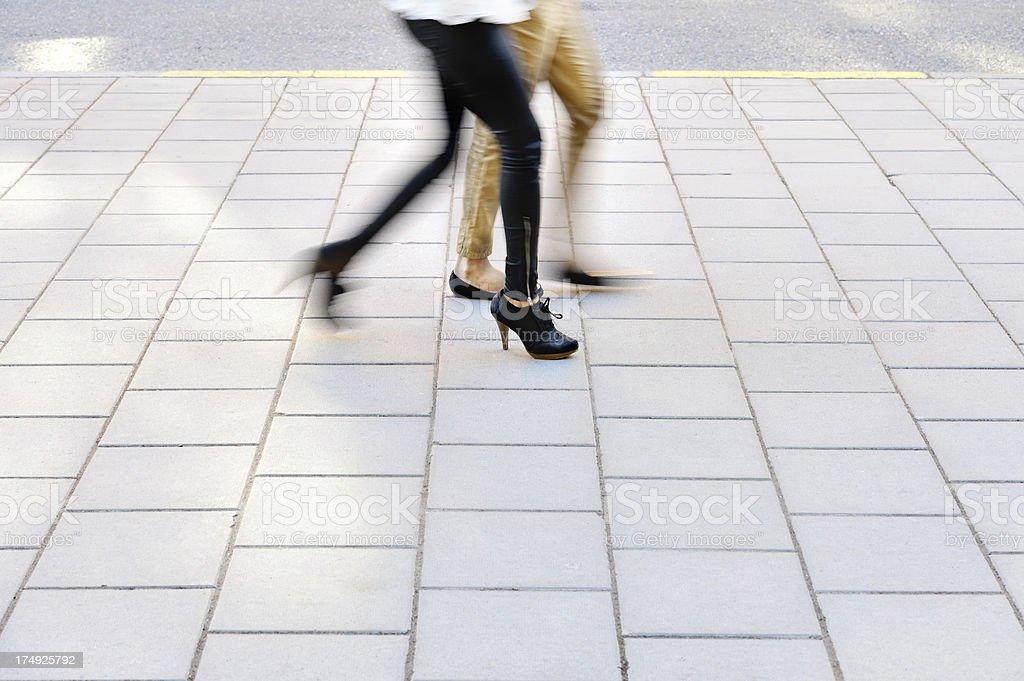 Blurred pedestrians on the sidewalk royalty-free stock photo