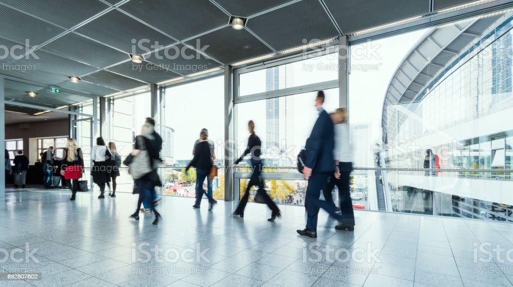 blurred people at Frankfurt trade fair stock photo