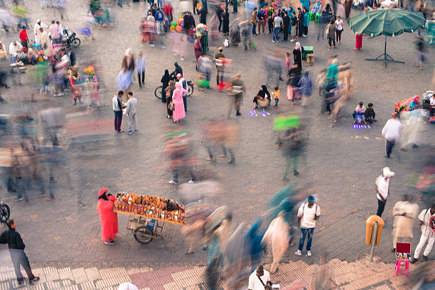 Blurred People at Market, Djemaa El Fna Square, Marrakech, Morocco stock photo