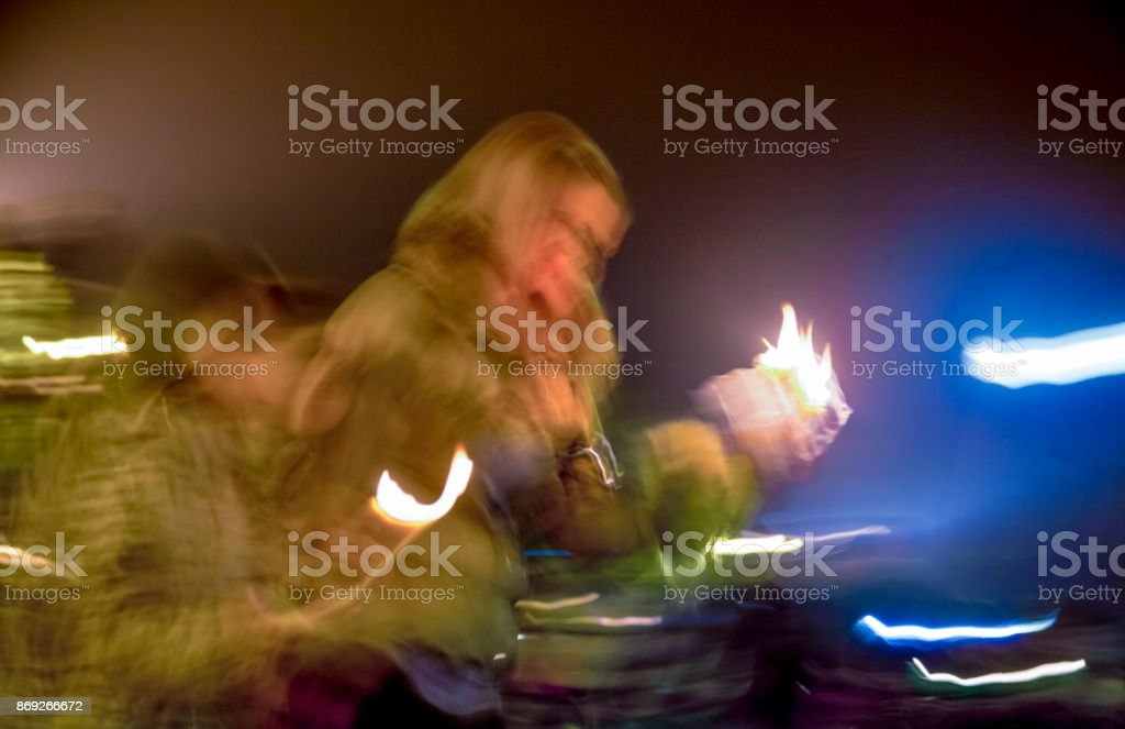 Blurred People Candles Outdoors stock photo