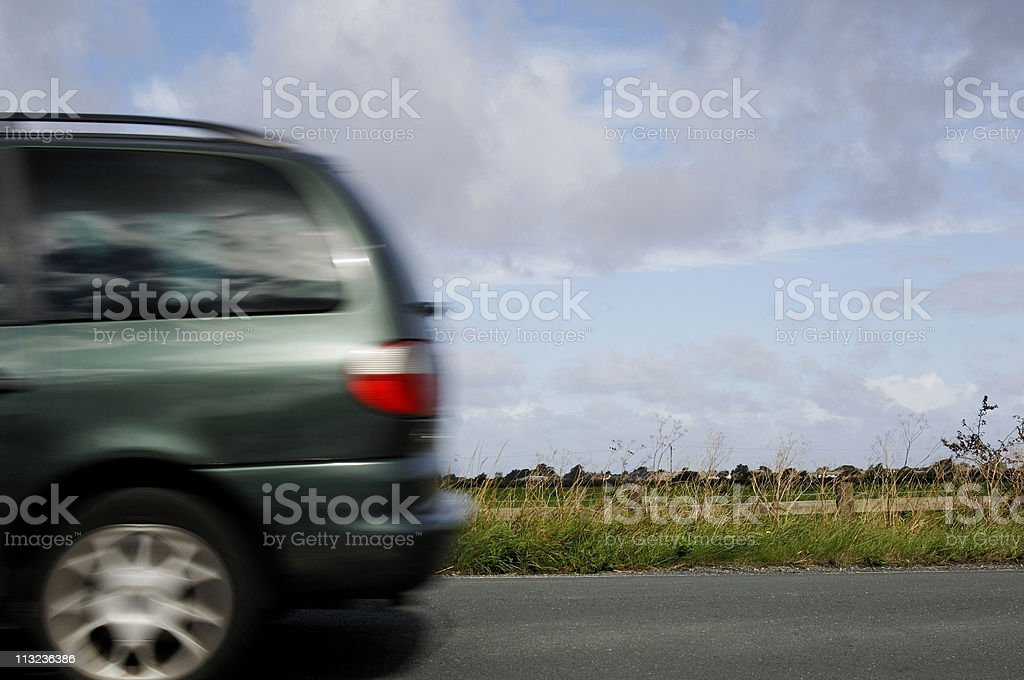 Blurred people carrier speeding down country road royalty-free stock photo