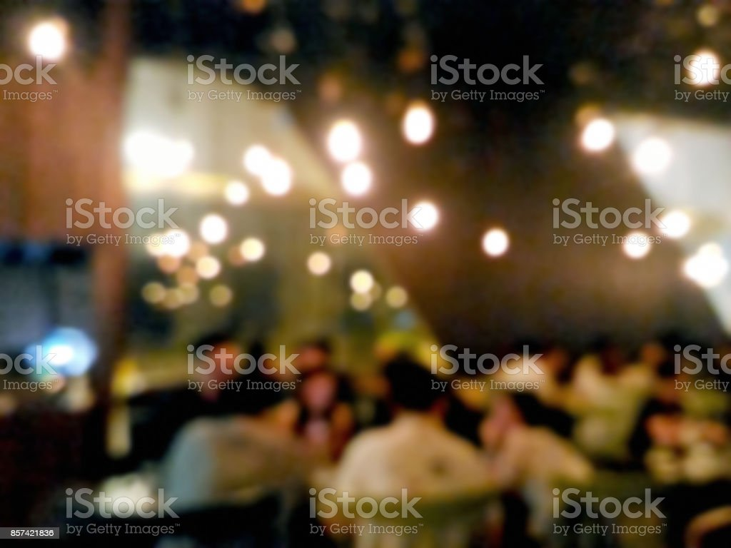 Blurred people drinking at the bar stock photo