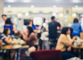 Blurred People eat and drink in Restaurant Shop cafe interior background