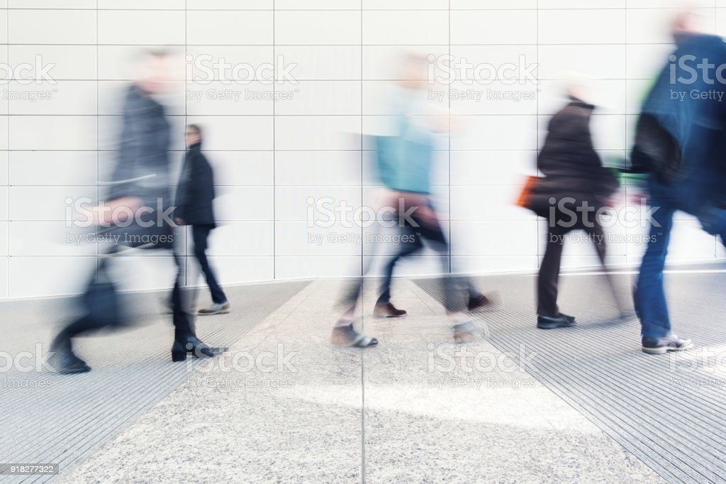 blurred people in a corridor stock photo