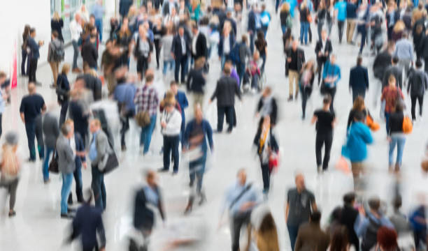 blurred people in a modern hall - crowded stock pictures, royalty-free photos & images