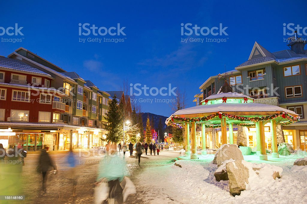 Blurred people in a snowy village in Whistler royalty-free stock photo