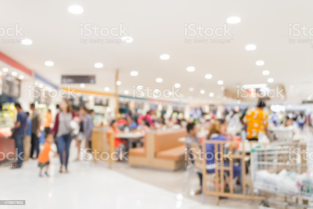Blurred people in food court stock photo