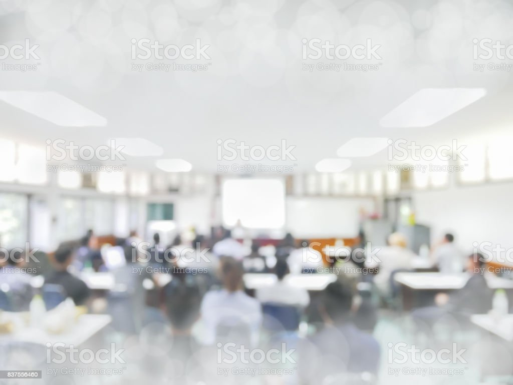 blurred people lecture in seminar room education or meetting concept ,abstract blur people background stock photo