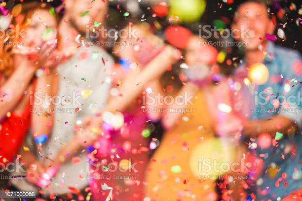 Blurred people making party throwing confetti young people on night picture id1071000086?b=1&k=6&m=1071000086&s=612x612&h=nw9oicoxxm7mbtn4z1cgphsghfbzyriy0naezjd30vs=