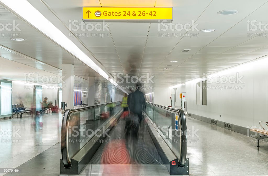 Blurred People On A Moving Walkway In An Airport stock photo