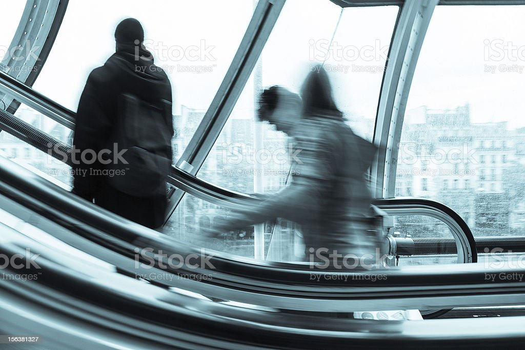 Blurred People on the Escalator royalty-free stock photo