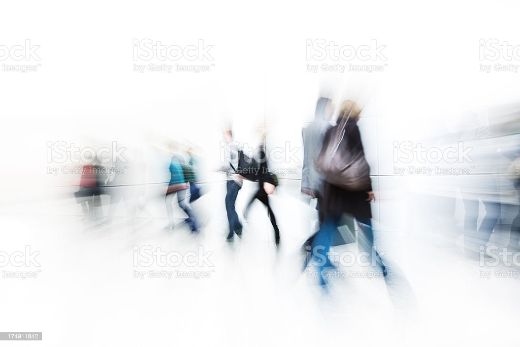 Blurred People Rushing Against White Background royalty-free stock photo