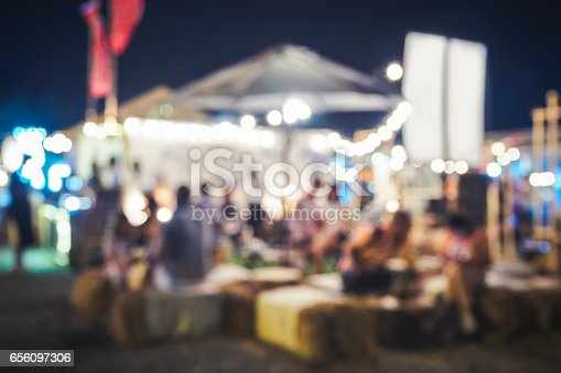 860440036 istock photo Blurred People siting Festival Event Party 656097306