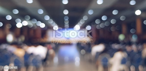 478810450 istock photo blurred people sitting at the conference 1158226763