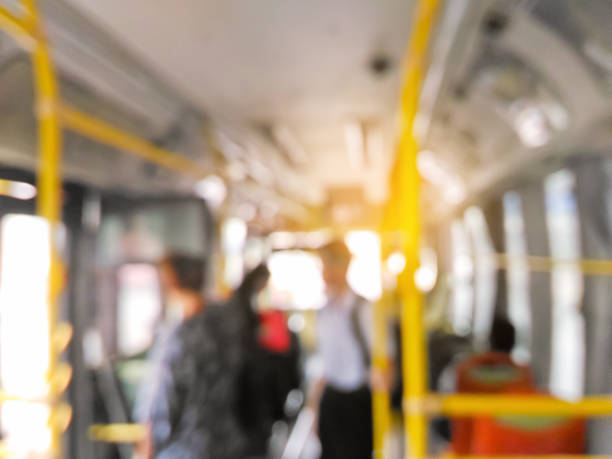 Blurred people standing on the bus stock photo