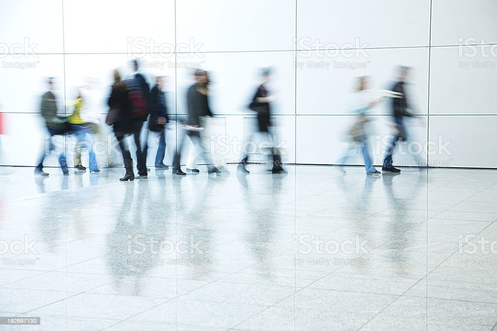 Blurred People Walking Down Corridor royalty-free stock photo