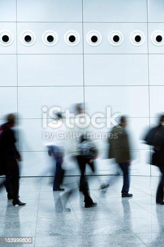 istock Blurred People Walking in a Modern Interior 153999800
