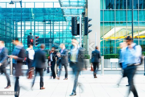 1146224410istockphoto Blurred People Walking in Front of Modern Office Building, London 187584811