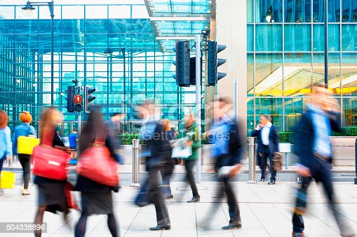1146224410istockphoto Blurred People Walking in Front of Modern Office Building, London 504338896
