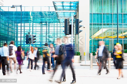 1146224410istockphoto Blurred People Walking in Front of Modern Office Building, London 511582594