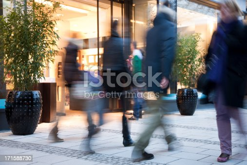 istock Blurred People Walking Past Illuminated Fashion Store 171588730