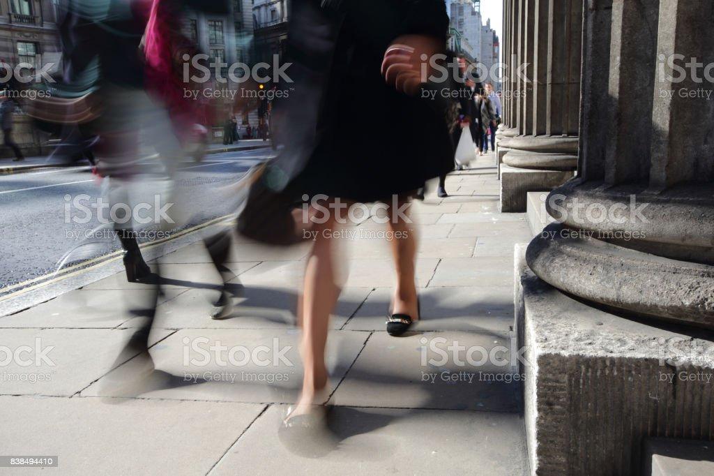 Blurred people walking stock photo
