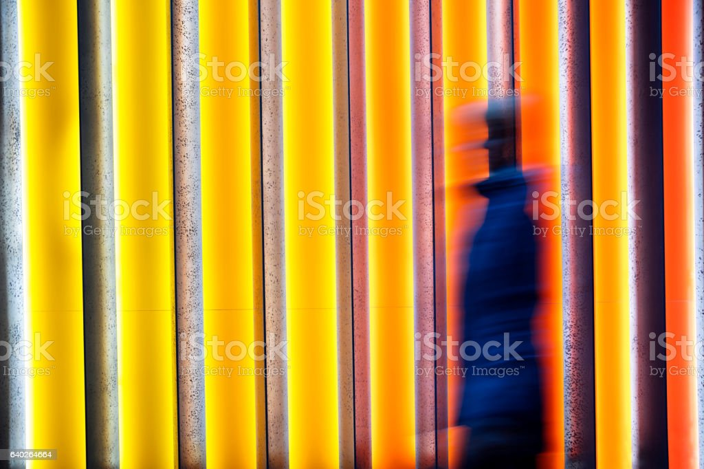 Blurred Person in Front of Colorful Background stock photo