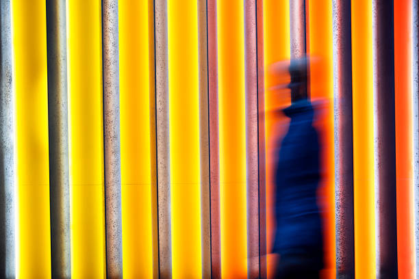blurred person in front of colorful background - saturated color stock pictures, royalty-free photos & images