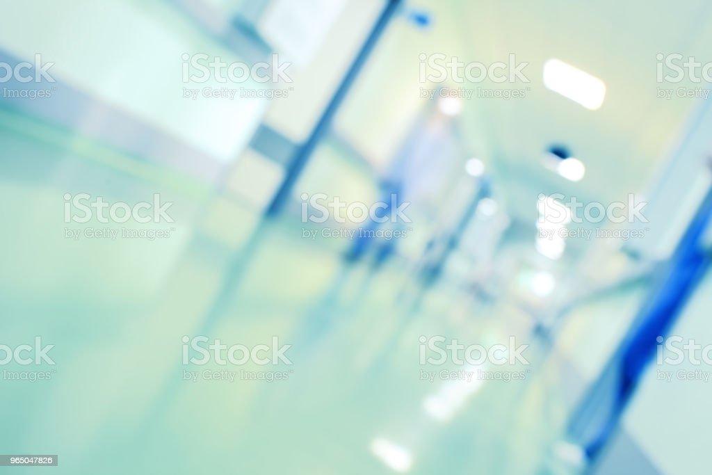 Blurred person in hospital hallway, unfocused background zbiór zdjęć royalty-free