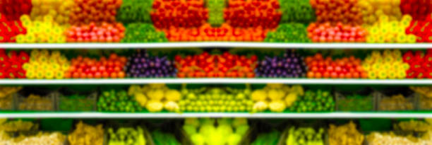 Blurred photo Fresh organic Vegetables and fruits on shelf in supermarket, farmers market. Healthy food concept. Vitamins and minerals. Tomatoes, capsicum, cucumbers, mushrooms, zucchini, stock photo