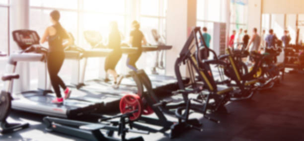 Blurred photo of a gym with people on treadmills Blurred photo of a gym with people on treadmills health club stock pictures, royalty-free photos & images