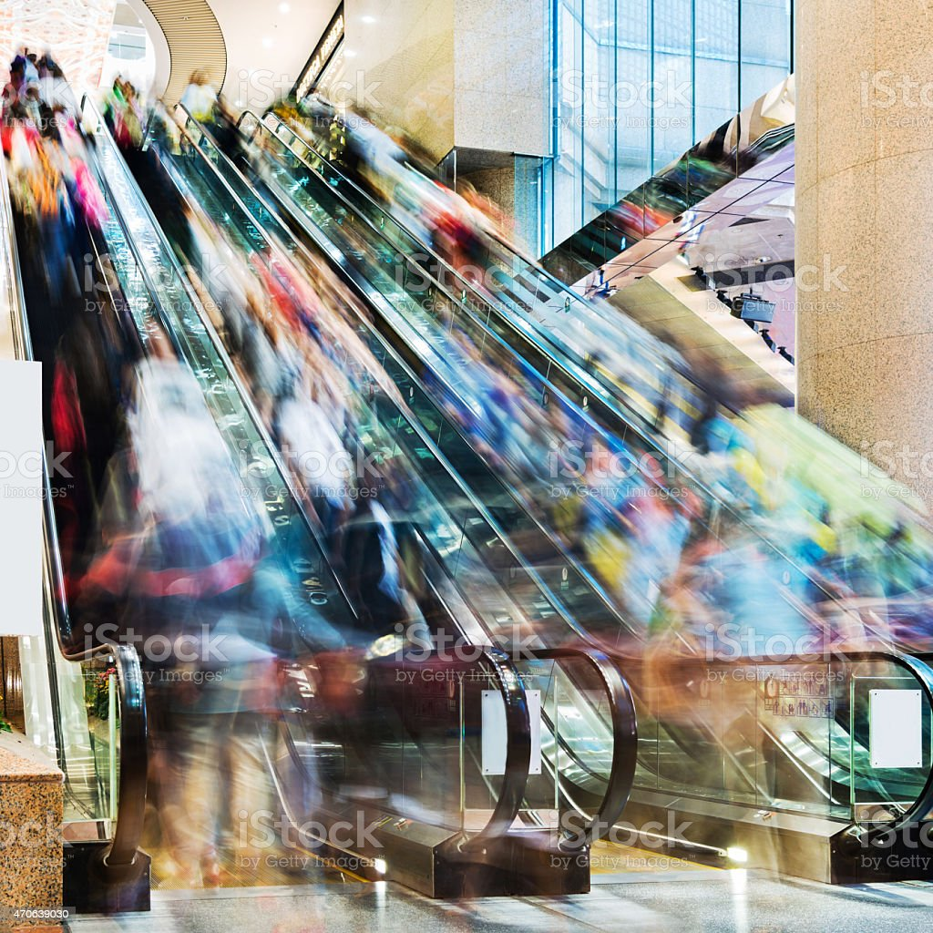 Blurred photo of crowds on an escalator stock photo