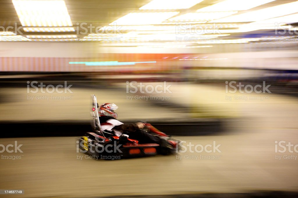 A blurred photo of indoor go karting royalty-free stock photo