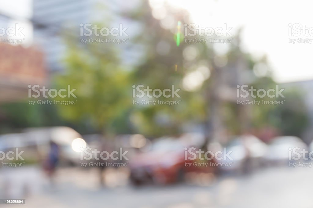 Blurred photo of outdoor car park in community shopping center. stock photo