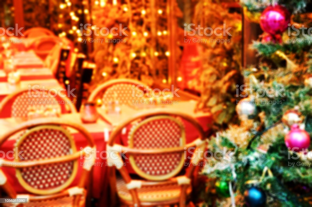 Christmas Paris France.Blurred Photo Of Parisian Cafe Terrace Decorated For