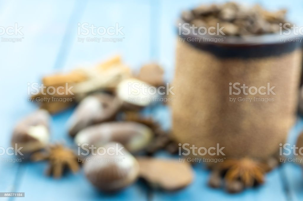 Blurred photo with a mug of coffee and chocolate. stock photo