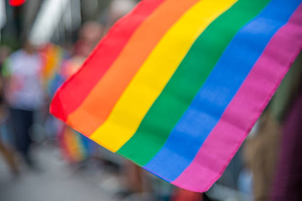 blurred picture of a gay rainbow flag - transsexual stock photos and pictures