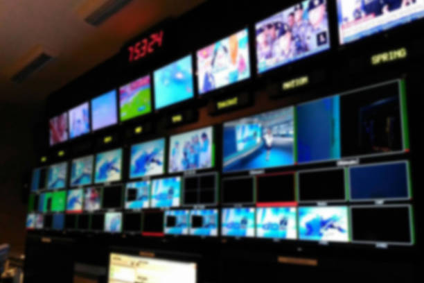 Blurred picture video switch of Television Broadcast, working with video and audio mixer, control broadcasts in recording studio. Blurred picture video switch of Television Broadcast, working with video and audio mixer, control broadcasts in recording studio. broadcasting stock pictures, royalty-free photos & images